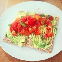 Post-run brunch of spelt crackers with avo and tomato