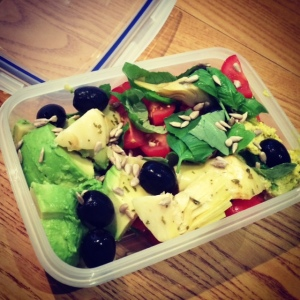 Basil, tomato, olive and avocado lunch salad