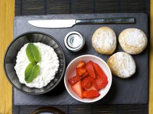 Vegan scones with coconut cream and strawberries
